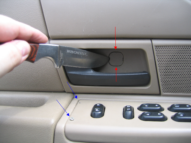 Removal And Replacement Of The Driver S Side Door Panel In A 2003 Ford Crown Victoria Police Interceptor
